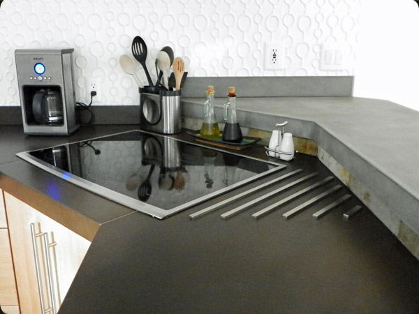 concrete counter with stainless steel trivet
