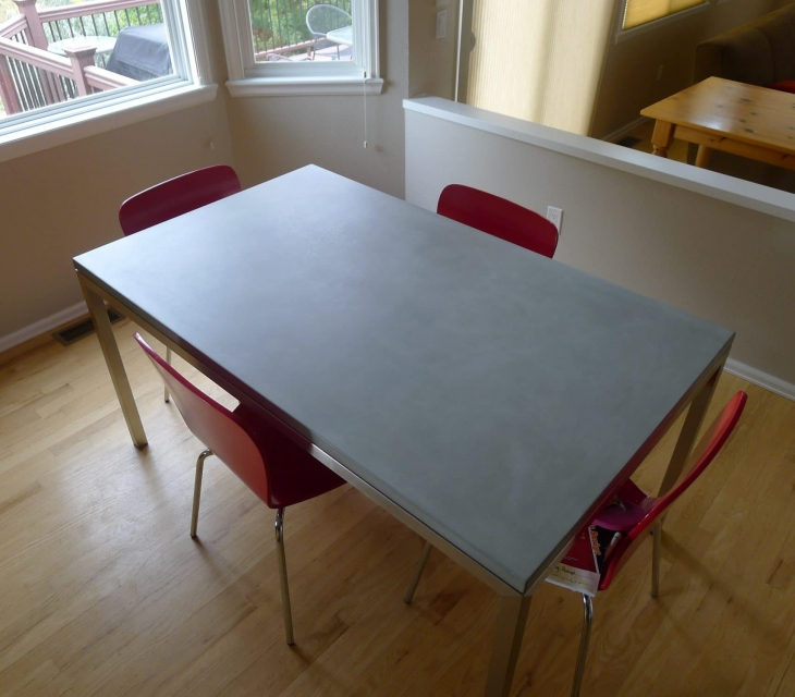 concrete and stainless steel dining table