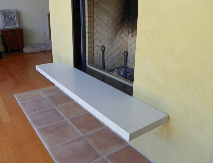 White concrete fireplace hearth
