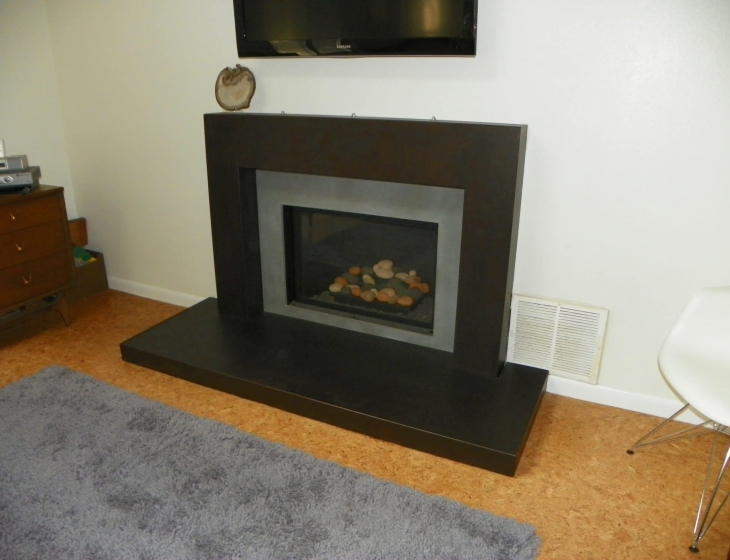 Boulder concrete fireplace surround