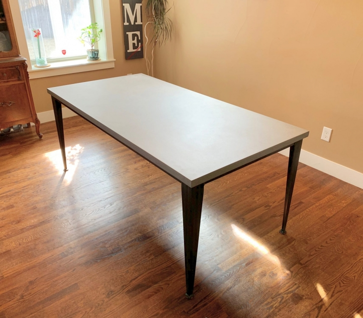 Concrete and steel dining table