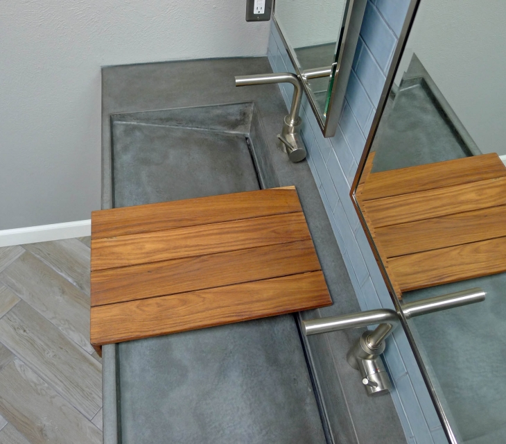 Concrete ramp sink with teak shelf