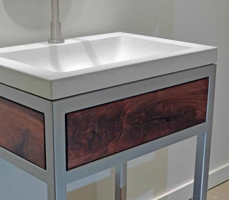 Concrete, steel,  and walnut vanity detail