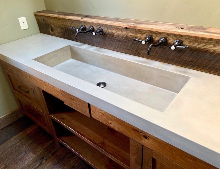 Boulder rustic master bathroom concrete sink