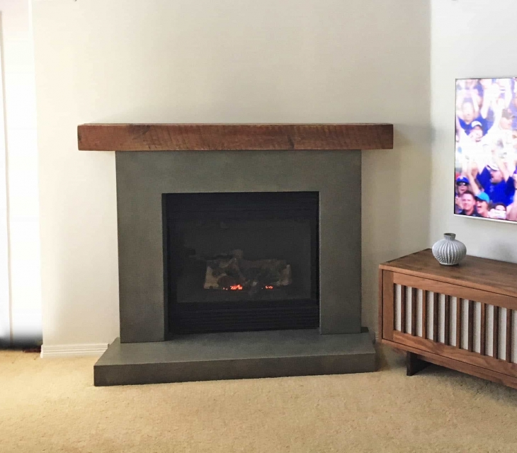 Reclaimed wood and concrete fireplace surround