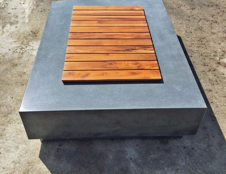 Concrete fire pit with teak cover