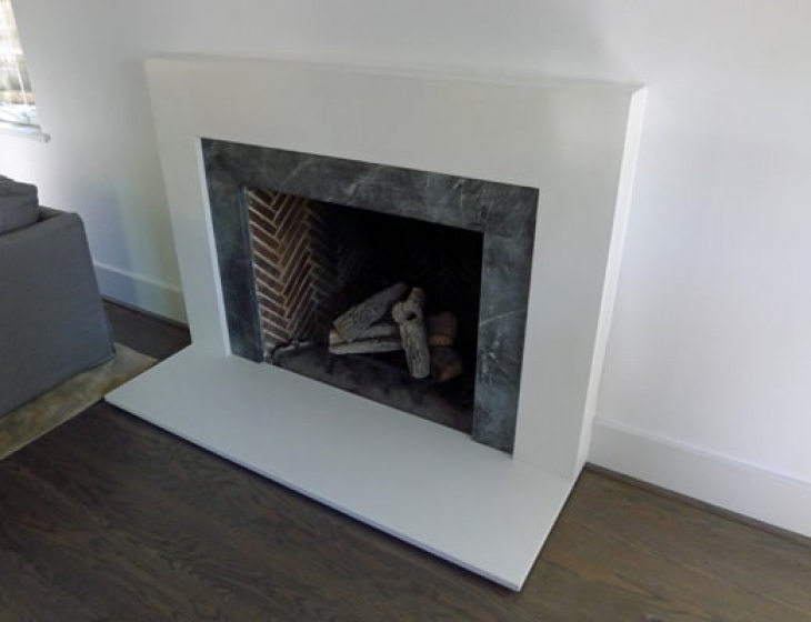 white concrete fireplace